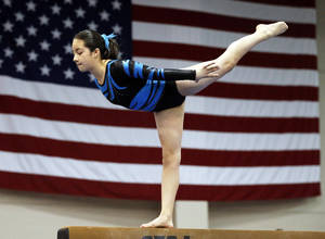 photo - Erica Pedraza, with Hopes and Dreams Gymnastics, warms up on the balance beam during the Nadia Comaneci International Invitational. Photo by  Steve Sisney, The Oklahoman