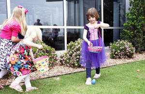 Photo - Lily Rose Botham, right, hunts for Easter eggs at ProCure Proton Therapy Center.  Photo by Sarah Phipps, The Oklahoman archives