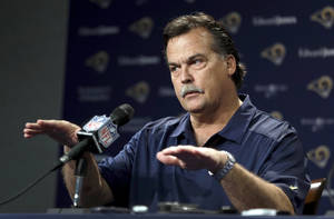 Photo - St. Louis Rams head coach Jeff Fisher speaks during a pre-draft news conference at the team's practice facility, Tuesday, May 6, 2014, in St. Louis. The Rams are scheduled to have two picks in the first-round of the NFL football draft on Thursday. (AP Photo/Jeff Roberson)