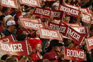 """Photo - Fans raise banner saying """"Boomer"""" during the first half of the college football game between the Texas A&M Aggies and the University of Oklahoma Sooners (OU) at Gaylord Family-Oklahoma Memorial Stadium on Saturday, Nov. 5, 2011, in Norman, Okla. Photo by Steve Sisney, The Oklahoman"""
