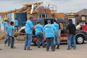 Photo - Volunteers from FreeBird World Burrito brought food to workers in the storm damaged neighborhoods of Moore. Photo provided <strong> - PROVIDED</strong>