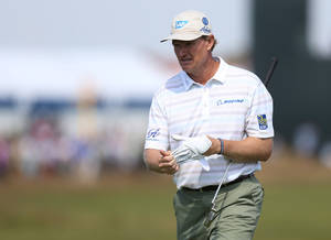 Photo - Ernie Els of South Africa waits to putt on the 5th green during the first day of the British Open Golf championship at the Royal Liverpool golf club, Hoylake, England, Thursday July 17, 2014. (AP Photo/Scott Heppell)