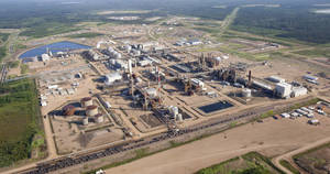 Photo - This Tuesday, July 10, 2012 aerial photo shows a Nexen oil sands facility near Fort McMurray, Alberta, Canada. On Friday, Dec. 7, 2012, Canada approved China's biggest overseas energy acquisition, a $15.1 billion takeover by state-owned CNOOC of Canadian oil and gas producer Nexen. (AP Photo/The Canadian Press, Jeff McIntosh)