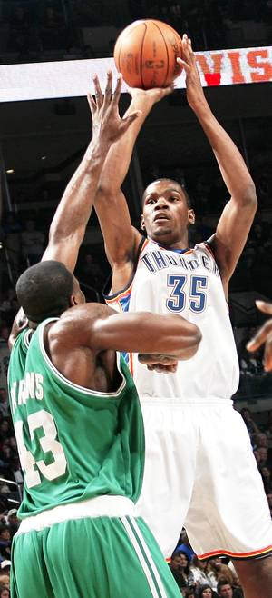photo - Oklahoma City's Kevin Durant shoots over Boston's Kendrick Perkins during the Celtics' 105-87 win Friday at the Ford Center. PHOTO BY NATE BILLINGS, THE OKLAHOMAN