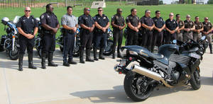 Photo - Motorcycle officers from Edmond, Oklahoma City, Tulsa, Broken Arrow and Oklahoma County sheriff's office gather to promote safety for Monday's national ride a motorcycle to work day. PHOTO BY DIANA BALDWIN, THE OKLAHOMAN