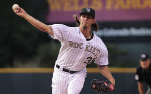 Photo - Colorado Rockies starting pitcher Christian Bergman delivers against the Milwaukee Brewers in the first inning of a baseball game in Denver, Friday, June 20, 2014. (AP Photo/Joe Mahoney)