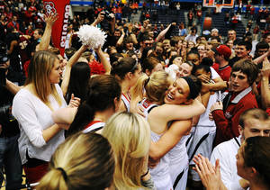 Photo - South Dakota players celebrate an 82-71 win over Denver during an NCAA college basketball game for the championship of the Summit League women's tournament Tuesday, March 11, 2014, in Sioux Falls, S.D. (AP Photo/Argus Leader, Joe Ahlquist) NO SALES