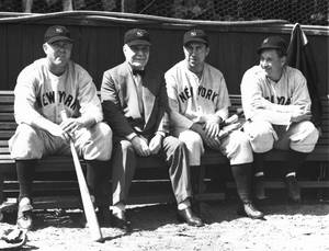 Photo - FILE - In this March 17, 1938 file photo, Col. Jacob Ruppert, second from left, owner of the world champion New York Yankees, sits with pitcher Paul Andrews, left, outfielder Ernie Koy and pitcher Bump Hadley, right, during spring training in St. Petersburg, Fla. Ruppert, longtime umpire Hank O'Day and barehanded catcher Deacon White were elected to the Hall of Fame on Monday, Dec. 3, 2012, for their excellence through the first half of the 20th century. (AP Photo/File)
