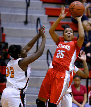 photo - Carl Albert's Gioya Carter, right, shoots the ball beside Putnam City's TaiZhon McClurkin during their girls high school basketball game at Carl ALbert in Midwest City, Okla., Friday, Jan. 25, 2013. Photo by Bryan Terry, The Oklahoman