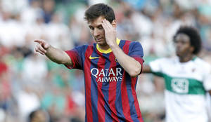 Photo - Barcelona's Lionel Messi from Argentina reacts after failing to score against Elche during a Spanish La Liga soccer match at the Martinez Valero stadium in Elche, Spain, on Sunday, May 11, 2014. (AP Photo/Alberto Saiz)
