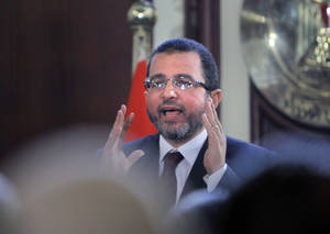 Photo - Egyptian Prime Minister Hesham Kandil talks during a press conference in Cairo, Egypt, Sunday, Dec. 30, 2012. Kandil says his country will resume talks in January with the International Monetary Fund over a $4.8 billion loan, after they were suspended during this month's political turmoil over the now-adopted constitution. (AP Photo/Amr Nabil)