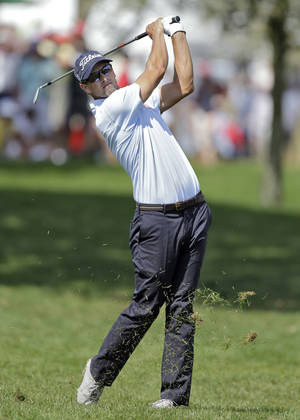 Photo - Adam Scott, of Australia, hits from the rough on the ninth hole during the second round of the Arnold Palmer Invitational golf tournament at Bay Hill Friday, March 21, 2014, in Orlando, Fla. (AP Photo/Chris O'Meara)