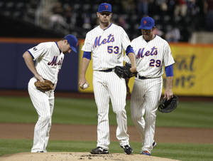 Photo -   REMOVES REFERENCE TO RELIEF PITCHER - New York Mets pitcher Jeremy Hefner waits to be taken out of the baseball game against the Philadelphia Phillies during the first inning, Thursday, Sept. 20, 2012, in New York. (AP Photo/Frank Franklin II)