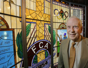 Photo - FCA founder Don McClanen stands in the chapel that was decided in his organization's honor at the Oklahoma Sports Hall of Fame on Friday. (Photo by David McDaniel, The Oklahoman)