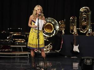 Carrie Underwood speaks at Checotah High School with some of the instruments that her C.A.T.S. Foundation and ACM Lifting LIves donated to the school Aug. 28, 2009. MIKE SIMONS/Tulsa World