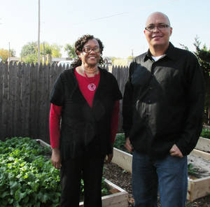 Photo - Linda Tillman and Arthur Younger of the Langston University Center for Community Engagement are pictured in the community garden at the Metropolitan Better Living Center, 702 NE 37.  PHOTO BY K.S. MCNUTT, THE OKLAHOMAN <strong>Kathryn McNutt</strong>