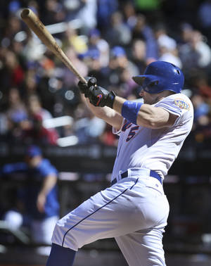 Photo -   New York Mets' David Wright hits a two-run homer during the first inning of the baseball game against the Miami Marlins Sunday, Sept. 23, 2012 at Citi Field in New York. (AP Photo/Seth Wenig)
