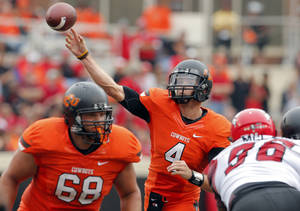 photo - Oklahoma State&#039;s J.W. Walsh (4) throws during a college football game between Oklahoma State University (OSU) and the University of Louisiana-Lafayette (ULL) at Boone Pickens Stadium in Stillwater, Okla., Saturday, Sept. 15, 2012. Photo by Sarah Phipps, The Oklahoman