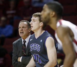 photo - Okahoma head coach Lon Kruger shouts from the bench in the first half of an NCAA college basketball game against TCU in Norman, Okla., Monday, Feb. 11, 2013. (AP Photo/Sue Ogrocki)