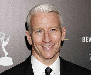 "Photo -   FILE - This June 23, 2012 file photo shows CNN's Anderson Cooper arrives at the 39th Annual Daytime Emmy Awards at the Beverly Hilton Hotel in Beverly Hills, Calif. Cooper came out in a letter online, saying ""the fact is, I'm gay."" He said Monday, July 2, in a note to the Daily Beast's Andrew Sullivan that he had kept his sexual orientation private for personal and professional reasons, but came to think that remaining silent had given some people an impression that he was ashamed. (Photo by Todd Williamson/Invision/AP, file)"