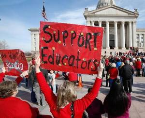 """Photo - Patsy Duck, a special education teacher from Hulbert, Okla., holds a sign urging Oklahoma lawmakers to """"support educators"""" during the rally for education at the Capitol in Oklahoma City, Tuesday, March 15, 2011, Photo by Jim Beckel"""