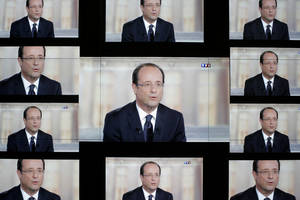 "Photo -   Socialist Party candidate for the presidential election Francois Hollande, is seen on a wall screen during the televised debate with President and conservative rival Nicolas Sarkozy, at the TF1 television studio, in Boulogne-Billancourt, outside Paris, Wednesday, May 2, 2012. The prime-time debate between conservative incumbent Sarkozy and his leftist challenger Hollande is billed in newspaper headlines Wednesday as ""The Last Duel"" and ""The Final Confrontation,"" providing a sense of suspense in a campaign that, if polls are right, has lacked it from the beginning. (AP Photo/Thibault Camus)"