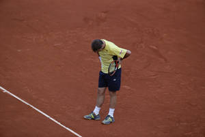 Photo - Switzerland's Stanislas Wawrinka bows his head after missing a return during the first round match of the French Open tennis tournament against Spain's Guillermo Garcia-Lopez at the Roland Garros stadium, in Paris, France, Monday, May 26, 2014. Wawrinka lost in four sets. (AP Photo/Michel Euler)
