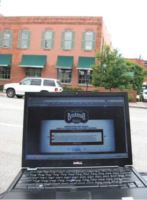 Photo - A laptop is shown with the Bricktown website. Some Bricktown locations will be offering free Wi-Fi.