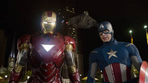 "Photo -   FILE - This file photo of a film image released by Disney shows Iron Man, portrayed by Robert Downey Jr., left, and Captain America, portrayed by Chris Evans, in a scene from ""The Avengers."" Disney/Marvel's ""The Avengers"" should top domestic box office for a third straight weekend, fending off wide-release newcomers with another $50 million in receipts. (AP Photo/Disney, File)"