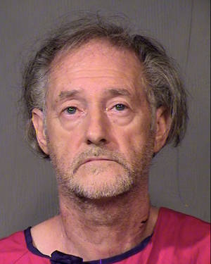 Photo - A photo released by the Maricopa County Sheriff's Office shows Eugene Maraventano, 63, who is charged with killing his wife and adult son. Maraventano, acknowledged fatally stabbing both, saying he feared he may have contracted the AIDS virus from prostitutes years earlier and given it to his wife, police said. (AP Photo/Maricopa County Sheriff's Office)
