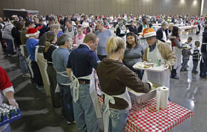 photo - Volunteers serve at the Red Andrews Christmas Dinner on Sunday, Dec. 25, 2011, in Oklahoma City, Okla. Photo by Steve Sisney, The Oklahoman <strong>STEVE SISNEY - THE OKLAHOMAN</strong>