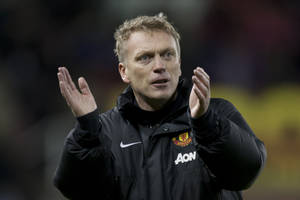 Photo - Manchester United's manager David Moyes applaudssupporters after his team's 2-0 win against Stoke in their English League Cup quarter-final soccer match at the Britannia Stadium, Stoke, England, Wednesday Dec. 18, 2013. (AP Photo/Jon Super)