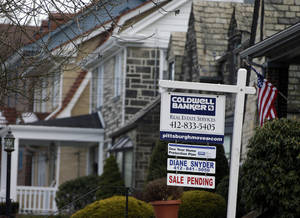 Photo - A sale pending sign is seen in the front yard of a home in Mt. Lebanon, Pa.  AP Photo