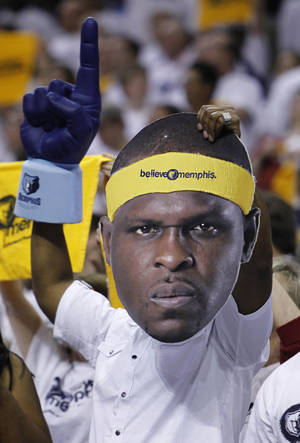 Photo - A Memphis Grizzlies fan holds a Zach Randolph cutout as he cheers during the second half of Game 6 against the Oklahoma City Thunder in a second-round NBA basketball playoff series on Friday, May 13, 2011, in Memphis, Tenn. (AP Photo/Wade Payne)