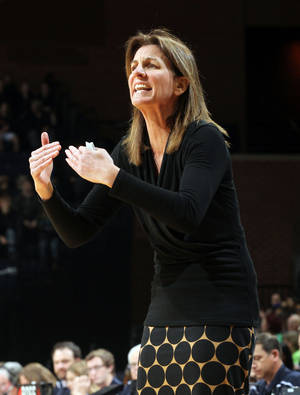 Photo - Virginia head coach Joanne Boyle reacts to a call during the first half of an NCAA basketball game against Notre Dame Sunday Jan. 12, 2014 in Charlottesville, Va. (AP Photo/Andrew Shurtleff)