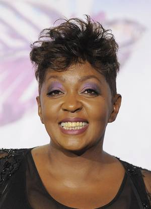 Photo - FILE- In this  June 26, 2011 file photo, Anita Baker poses backstage at the BET Awards in Los Angeles. An arrest warrant has been issued for Grammy Award-winning singer Anita Baker. A company says Baker owes it $15,000 for work done on her Grosse Pointe, Mich., home. (AP Photo/Chris Pizzello, File)