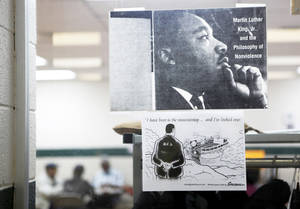 Photo - A poster depicting Martin Luther King Jr. hangs on a window at the  Lincoln Park Senior Center, 4712 N Martin Luther King Ave.  PHOTOs BY SARAH PHIPPS, THE OKLAHOMAN