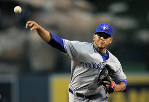Photo -   Toronto Blue Jays starting pitcher Henderson Alvarez throws to the plate during the second inning of their baseball game against the Los Angeles Angels, Friday, May 4, 2012, in Anaheim. (AP Photo/Mark J. Terrill)