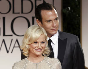 Photo -   FILE - This Jan. 15, 2012 file photo shows actors Amy Poehler, left, and Will Arnett arriving at the 69th Annual Golden Globe Awards in Los Angeles. The couple is separating after 9 years of marriage, their publicist Lewis Kay confirmed Thursday, Sept. 6. Poehler and Arnett have two young sons, 3-year-old Archie and 2-year-old Abel. (AP Photo/Matt Sayles, file)
