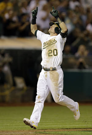 Photo - Oakland Athletics' Josh Donaldson celebrates after hitting a two-run home run off Houston Astros' Philip Humber in the sixth inning of a baseball game Friday, Sept. 6, 2013, in Oakland, Calif. (AP Photo/Ben Margot)