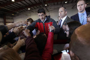 Photo -   Republican vice presidential candidate, Rep. Paul Ryan, R-Wis., greets the supporters during a campaign event at Richmond International Airport,, Saturday, Nov. 3, 2012 in Richmond, Va. (AP Photo/Mary Altaffer)