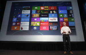 Photo -   Kirk Koenigbauer, Corporate Vice President of Microsoft Office Division, speaks at a Microsoft event in San Francisco, Monday, July 16, 2012. Microsoft unveiled a new version of its widely used, lucrative suite of word processing, spreadsheet and email programs Monday, one designed specifically with tablet computers and Internet-based storage in mind. (AP Photo/Jeff Chiu)