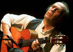 Photo - FILE - In this July 12, 2001 file photo, Spanish guitarist Paco de Lucia performs during the 35th Montreux Jazz Festival in Montreux, Switzerland. Jose Ignacio Landaluce, mayor of de Lucia's native Spanish town of Algeciras said in a statement Wednesday Feb. 26, 2014 the world-renowned flamenco guitarist Paco de Lucia has died in Mexico, where he lived. He was 66. The cause of death was not immediately made known. (AP Photo/Keystone, Laurent Gillieron, File)