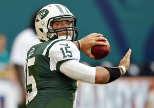 "Photo -   FILE - In this Sept. 23, 2012, file photo, New York Jets quarterback Tim Tebow (15) warms ups before an NFL football game against the Miami Dolphins in Miami. New Yorkers wonder if ""Tebow Time"" should start Monday against the undefeated Houston Texans. With the Jets 2-2 coming off a disheartening 34-0 loss to San Francisco, fans are ready for a change, ready to find out if they got the fierce competitor, as advertised, or a publicity stunt. (AP Photo/Wilfredo Lee, File)"