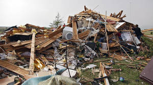 photo - The remains of the house owned by Scott and M'Lynn McCann that was destroyed by a tornado west of El Reno, Tuesday, May 24, 2011. Photo by Chris Landsberger, The Oklahoman ORG XMIT: KOD