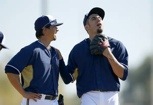 Photo - Milwaukee Brewers' Matt Garza, right, jokes around with teammate Kyle Lohse during Brewers MLB spring training baseball practice for pitchers and catchers, Monday, Feb. 17, 2014, in Phoenix. (AP Photo/Ross D. Franklin)