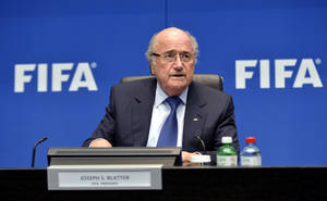 "Photo - FIFA President Joseph ""Sepp"" Blatter speaks during a press conference at the conclusion of the meeting of the FIFA Executive Committee at the Home of FIFA in Zurich, Switzerland, Friday, March 21, 2014. Among other topics, the FIFA Executive Committee covered sports political matters including an update on the workers' welfare in Qatar. (AP Photo/Keystone,Walter Bieri)"