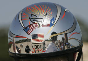 Photo - This is a motocycle helmet worn by Jim Watson, of Edmond, during motorcycle safety training Saturday July 26, 2008 at Edmond Fire Station 5. THE OKLAHOMAN.ARCHIVES