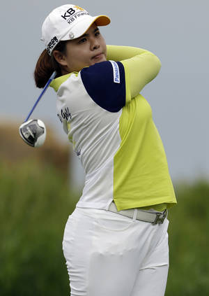 Photo - Inbee Park, of South Korea, tees off on the 16th hole during the first round of the U.S. Women's Open golf tournament at the Sebonack Golf Club Thursday, June 27, 2013, in Southampton, N.Y.  (AP Photo/Frank Franklin II)
