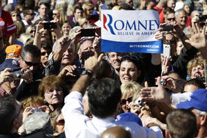 Photo -   Republican presidential candidate, former Massachusetts Gov. Mitt Romney campaigns at the Mobility Supercenter in Richmond, Va., Friday, Oct. 12, 2012. (AP Photo/Charles Dharapak)